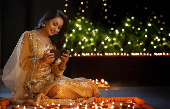 Woman clicking a picture of the decoration  on her phone