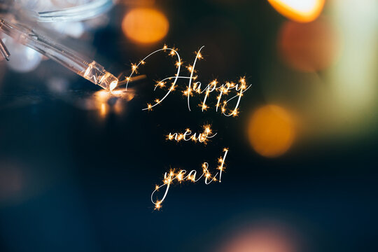Beautiful lights with sparkling 'Happy new year!' text.