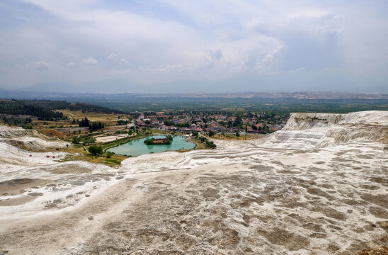 Pamukkale, Turkey - may 2018: Tourists on Pamukkale Travertine pools and terraces. Pamukkale is famous UNESCO world heritage site in Turkey