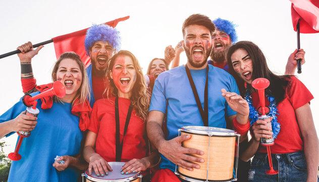 Portrait Of Cheerful Fans Enjoying Against Clear Sky