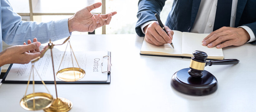 Businesswoman and Male lawyer or judge consult and conference having team meeting with client at law firm in office, Law and Legal services concept