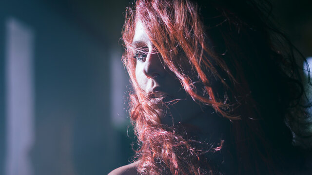 Close-up Cinematic Portrait Of Beautiful Actress With Wind In Her Red Hair