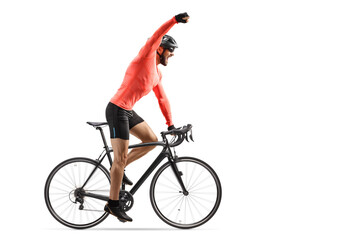 Male cyclist riding a road bicycle and gesturing win with hand