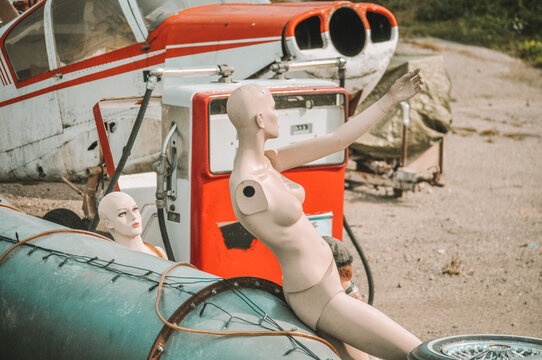 Side View Of A  Manikin And Junk Car