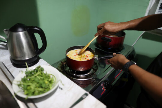 Maynor, 32, cooks dinner for his sisters at his home in California