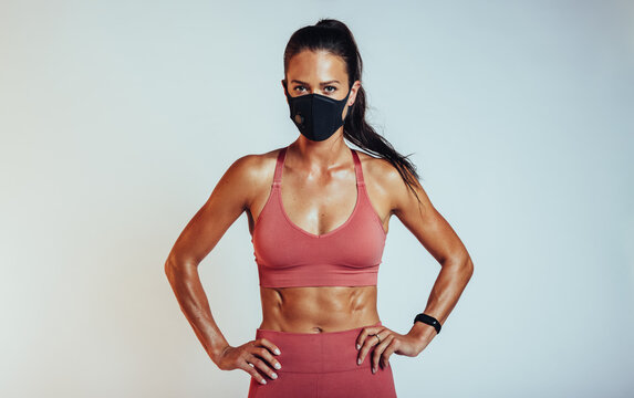 Woman with muscular body wearing face mask