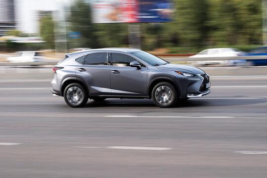 Ukraine, Kyiv - 24 September 2020: Gray Lexus NX car moving on the street