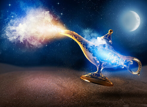 Smoke exists from magic aladdin genie lamp in a desert