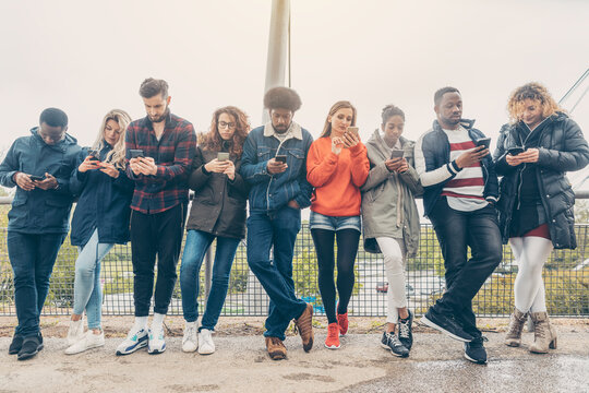 Group of young people staring on their phones
