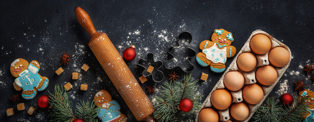 Christmas gingerbread on dark background with decorations top view. Holiday celebration and cooking concept