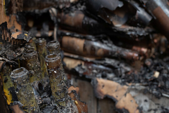 Wine bottles are seen destroyed at Castello di Amorosa winery after Glass Fire in Calistoga