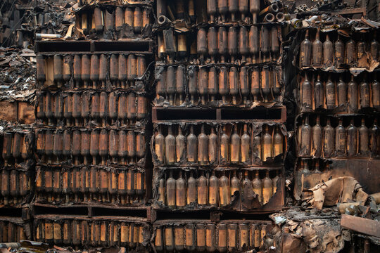 Wine bottles are seen destroyed at Castello di Amorosa winery after Glass Fire in Calistoga, California