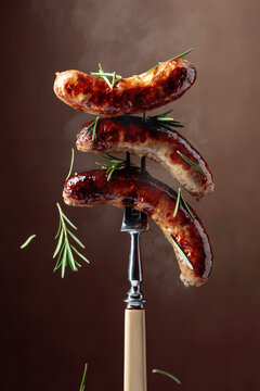 Grilled Bavarian sausages with rosemary.