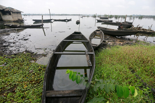 Canoes are seen on the banks of a river in Ogoniland, Rivers State