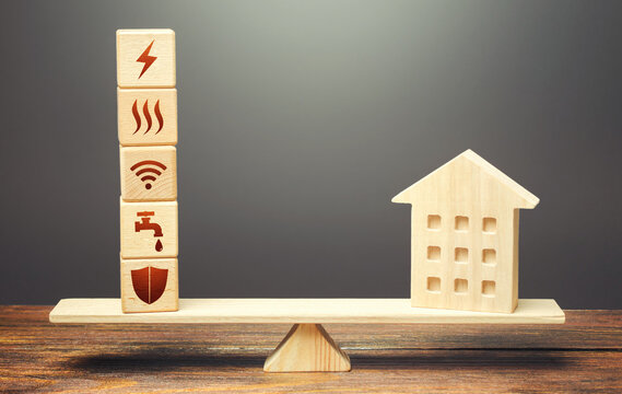 House and blocks with utilities public service symbols on scales. Home is too big and its maintenance costs are high. Availability of bill payment. Improve water and energy efficiency. Energy saving