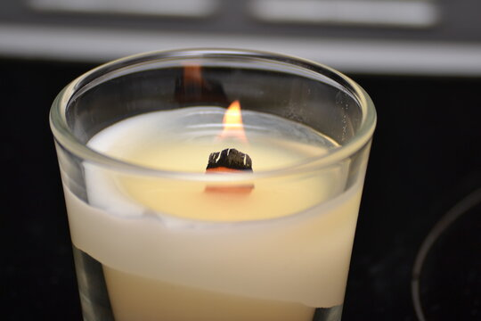 burning candles with wooden wick