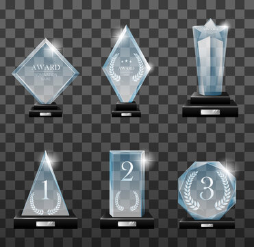 Glass trophy awards set. Vector isolated image fogged crystal award designs shape on board pedestal for awarded champion