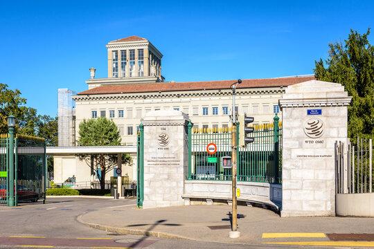 Geneva, Switzerland - September 3, 2020: Entrance of the World Trade Organization (WTO) headquarters, an intergovernmental organization dealing with regulation of international trade between nations.
