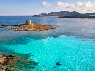 Stintino, turquoise sea water, coastline and tower. Sardinia, Italy