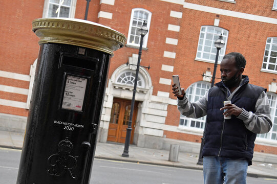 Royal Mail postboxes painted black instead of traditional red to honour Black Britons, unveiled as part of the forthcoming Black History Month, in London, Britain
