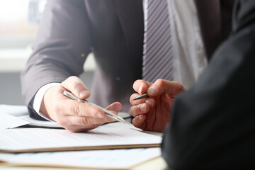Male arm in suit and tie fill form clipped pad with silver pen closeup. Sign gesture read pact sale agent bank job make note loan credit mortgage investment finance executive chief legal teamwork law Fotobehang