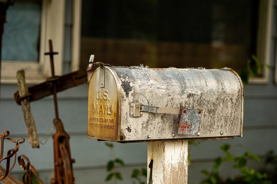 Old mailbox at an abandoned house