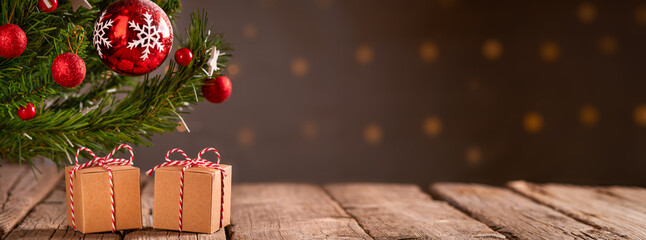 Christmas banner background, gifts on old wooden floor, Christmas tree