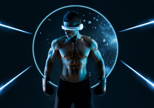 Muscular model sports young man in glasses of virtual reality and boxing gloves on dark background. Fashion portrait of strong brutal guy. Sexy torso. Male flexing his muscles. VR. Blue neon light.