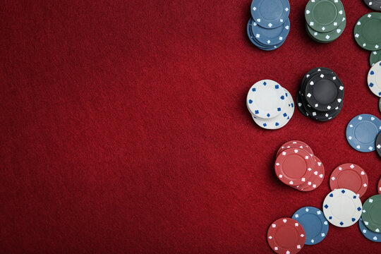 Poker chips on red table