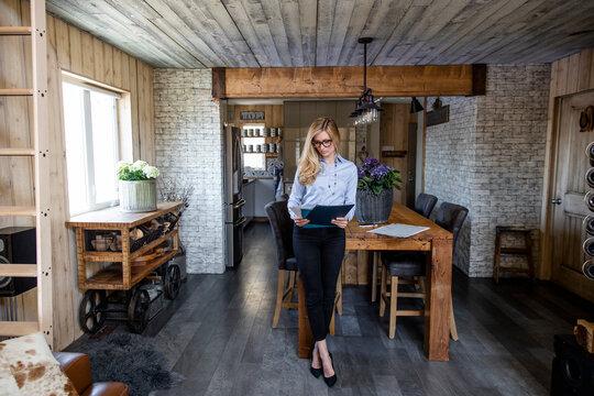 Estate agent reading documents in rustic interior