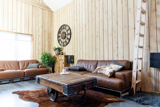 Rustic interior with wood panels and furniture