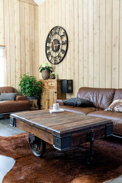 Wooden table and brown leather sofa