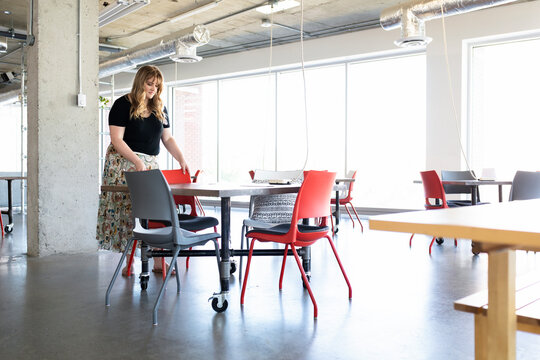 Woman preparing for business meeting in coworking space