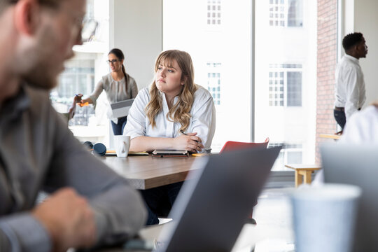 Businesswoman contemplating plans in the middle of coworking space