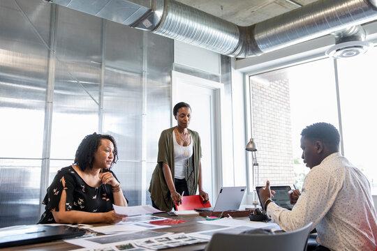 Creative explaining work in a design team planning meeting