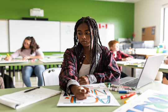 Student working at desk in class