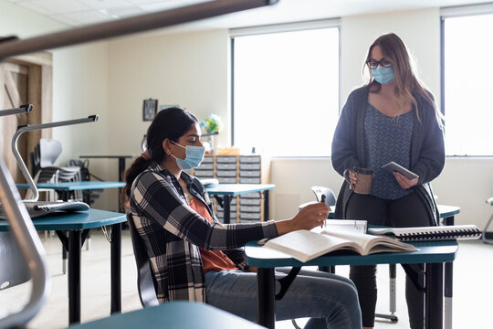 Student and teacher wearing masks in class