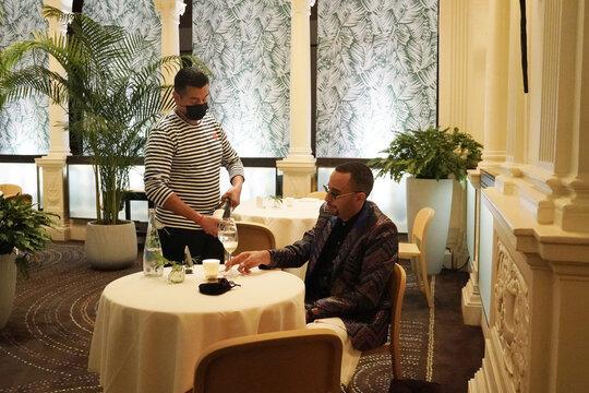 A diner eats at restaurant Daniel