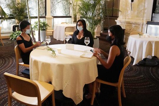 Diners eat at restaurant Daniel