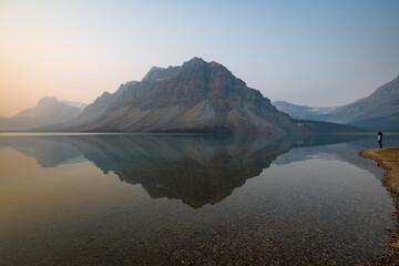 Mountains and glaciers reflected over Bow Lake in Alberta, Canada