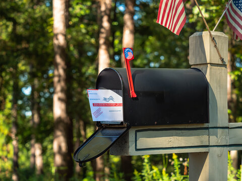 ATLANTA, GEORGIA - SEPTEMBER 30, 2020 : Absentee voter vote by mail ballot in U.S. Post Office residential mailbox.