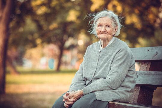 Portrait of senior woman in autumn park
