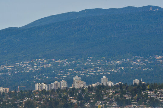 Single family homes and condo towers are seen in North Vancouver