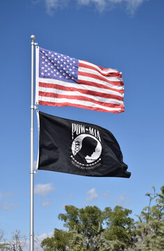 American and POW MIA flags in the wind