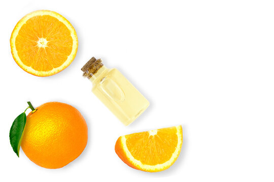 Orange essential oil in glass bottle and mandarin orange fruit isolated on white background. Top view.Flat lay.