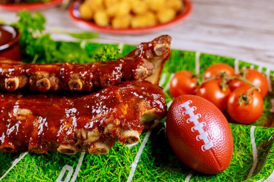 Pork ribs with barbecue sauce for american football party.