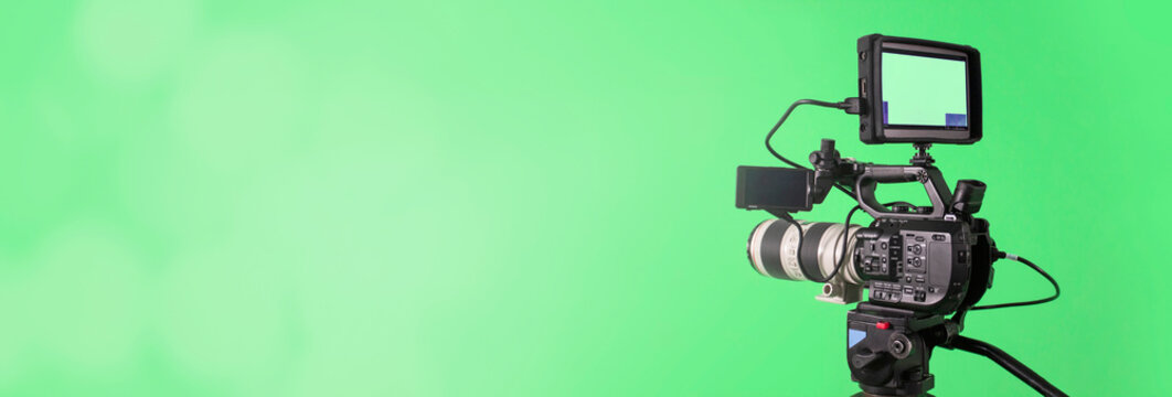 video camera on lighty green background, movie or television broadcasting banner