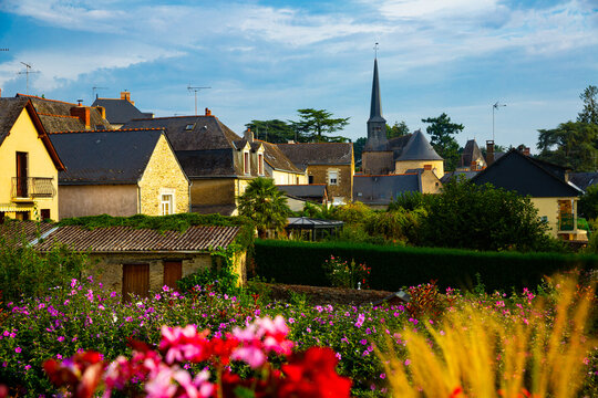 Picturesque view of houses and church of Grez-Neuville commune in Maine-et-Loire department, western France