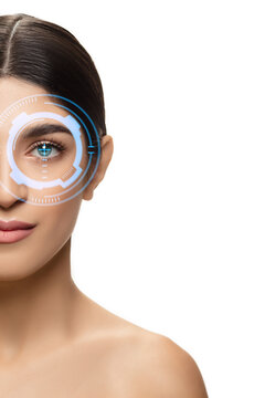 Future woman with cyber technology eye panel, cyberspace interface, ophthalmology concept. Beautiful female eye with modern identification tech, medical treatment for eyes, focus. Copyspace.