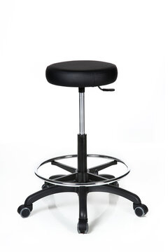 A modern, fancy office stool with wheels.